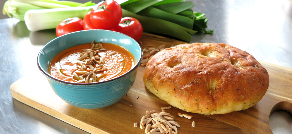Roast pepper and tomato bisque with almonds and seeded sour dough