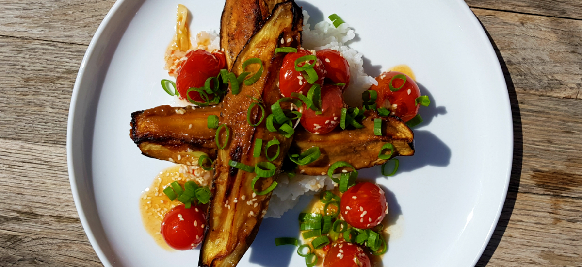 Miso eggplant with sticky rice, blistered cherry tomatoes, sesame and pak choi