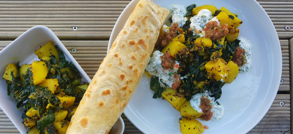 Bombay potatoes and cavolo nero with achar sauce, yoghurt and flat breads