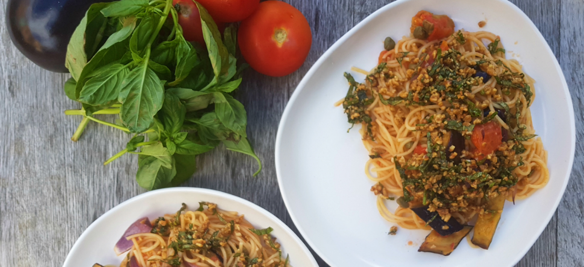 Roast eggplant and tomato spaghetti with capers and rustic walnut pesto