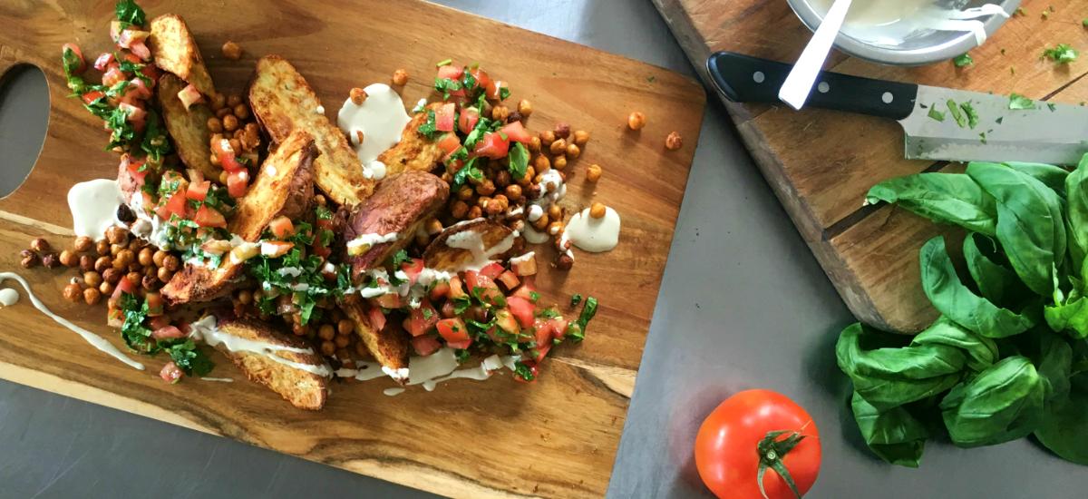 Mediterranean kumara with roast chickpeas, parsley, tomato salsa, and tahini