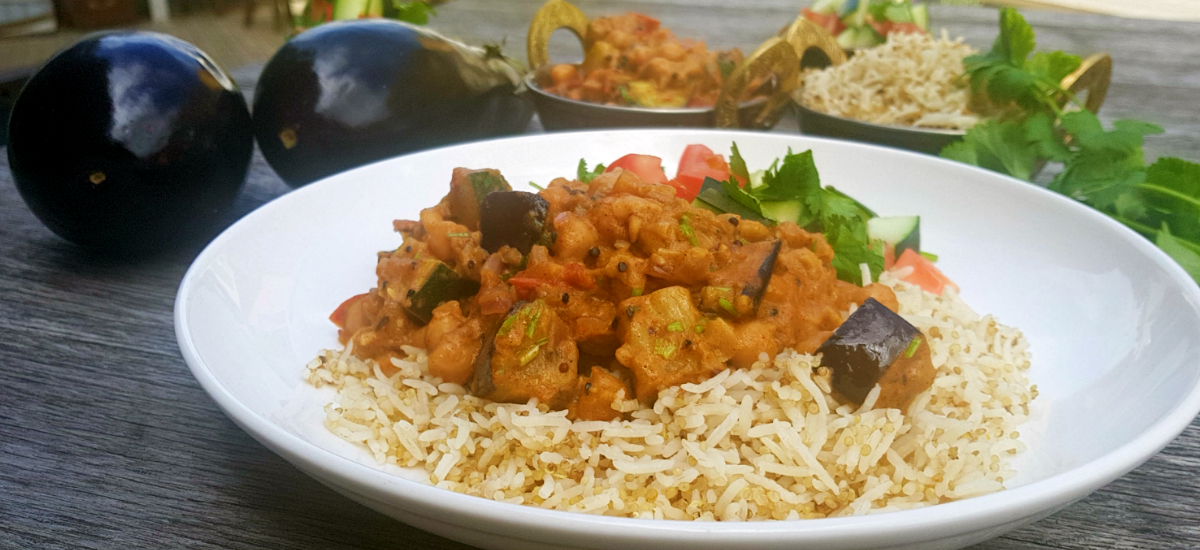 Smoky brinjal with chickpea and zucchini curry, local quinoa and tomato salad