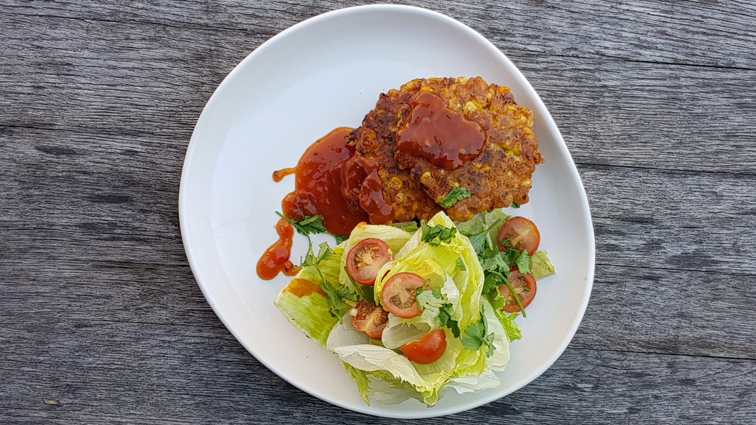 Corn fritters with sweet chili, wedge salad and cumin lime dressing