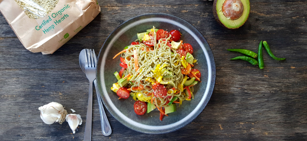 Spring noodle salad with avocado hemp seed sauterkraut and lemon maple dressing
