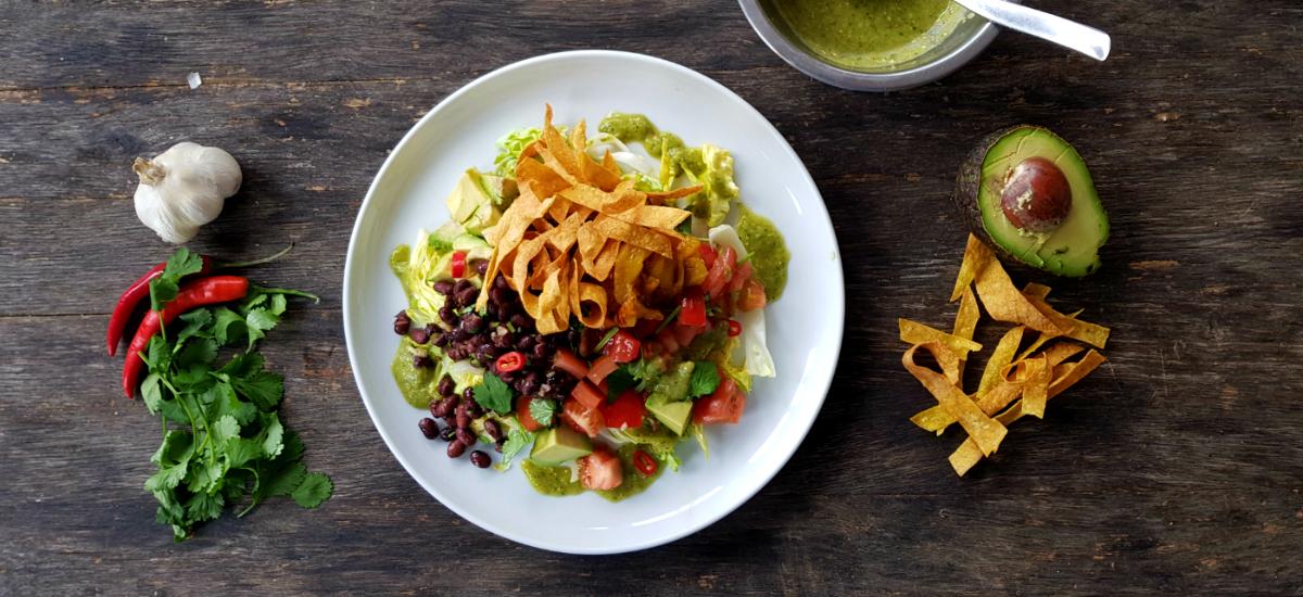 Taco salad garlic roast pepper cumin beans romaine avocado and tomatillo salsa