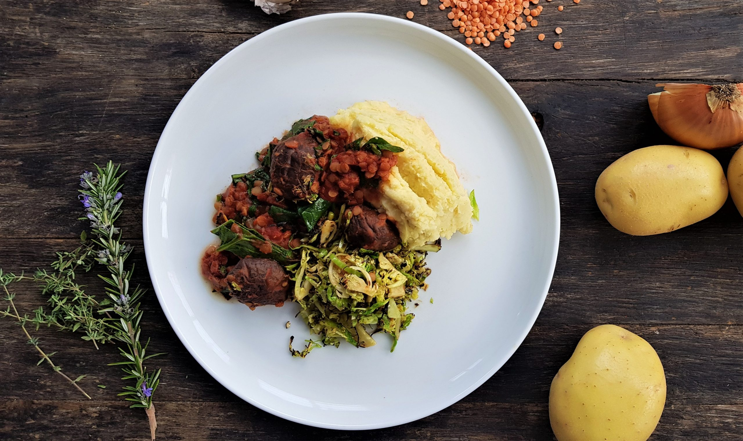 Mushroom, split pea and red wine ragu with mashed potato and charred Brussels sprouts