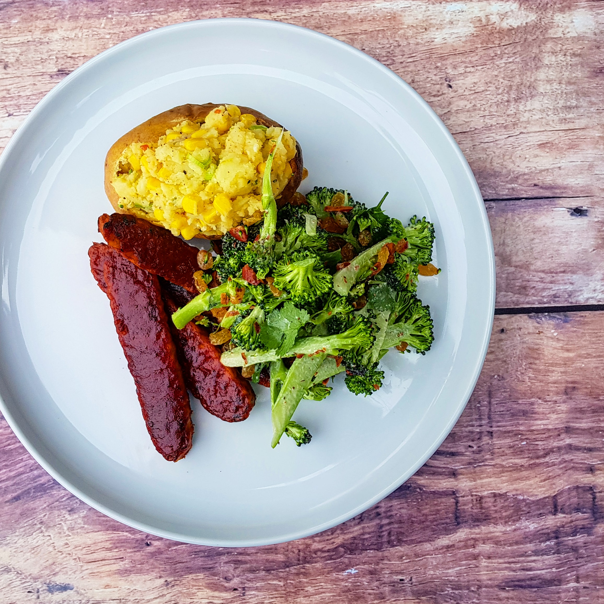BBQ tempeh 'ribs', lemon thyme and corn stuffed potatoes, broccoli, almond and golden raisin ranch salad