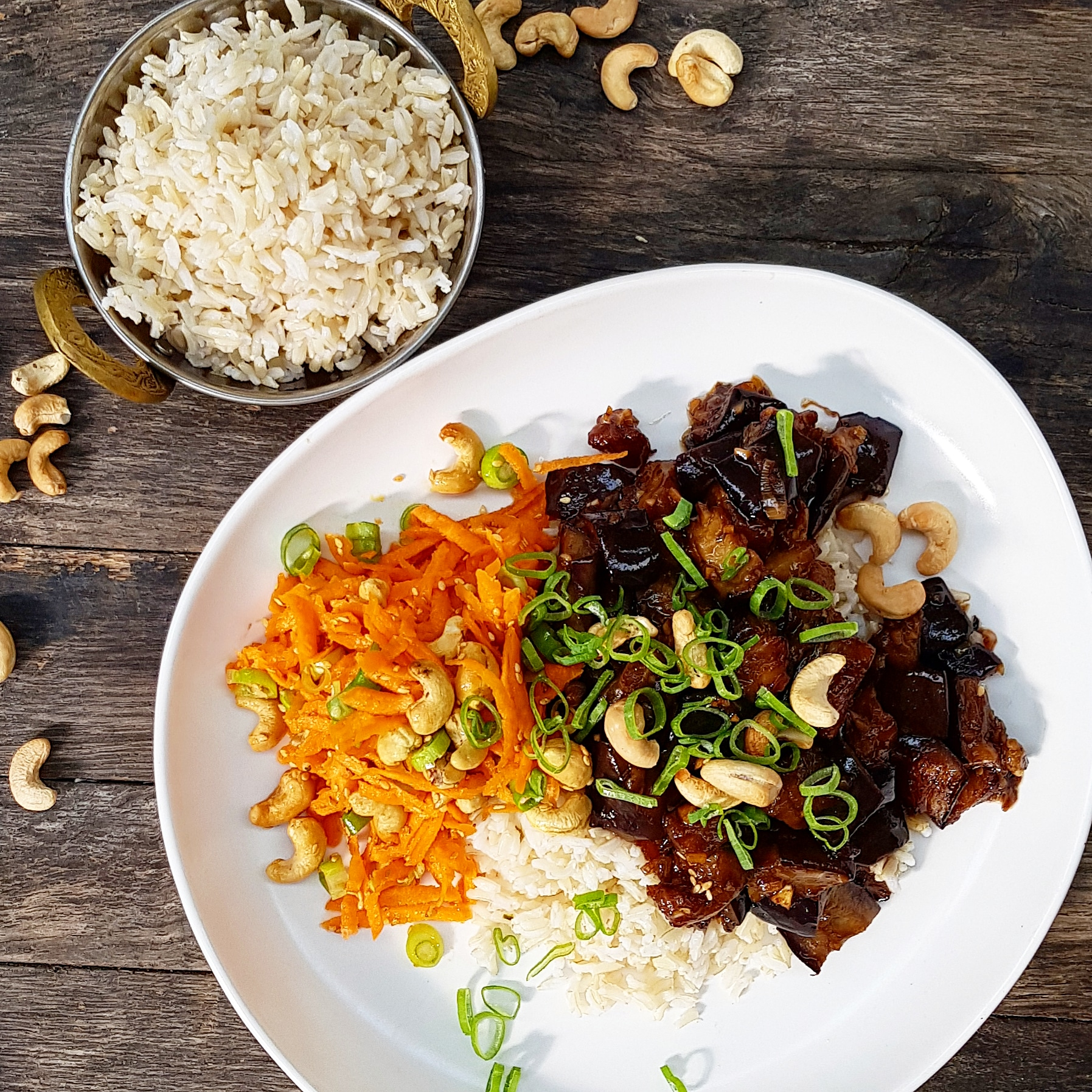 Eggplant and tamarind stir fry, kecap manis, carrot sesame slaw, brown rice and cashew